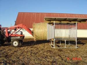 Customer Loading the Klene Pipe Hay Saver Hay Feeder